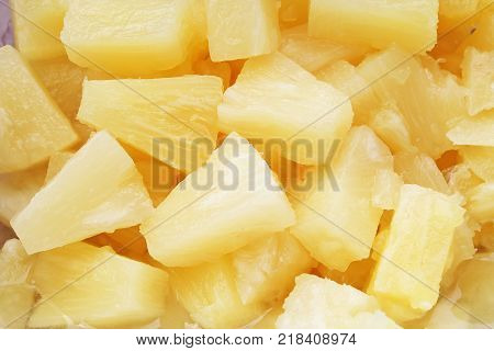 Pineapple slices as background. Yellow pineapples texture pattern. Pineapple fruit.