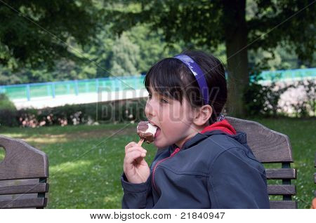 Girl eat ice cream.