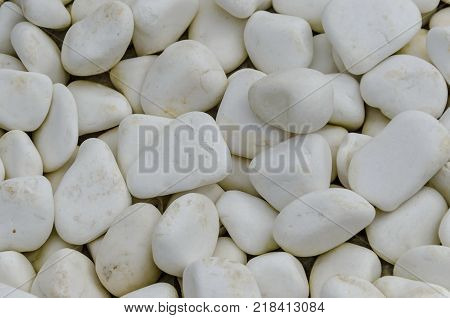 White background of cobble piece marble in garden at National monument of landscape architecture Park museum Vrana in former time royal palace on the outskirts of Sofia, Bulgaria, Europe