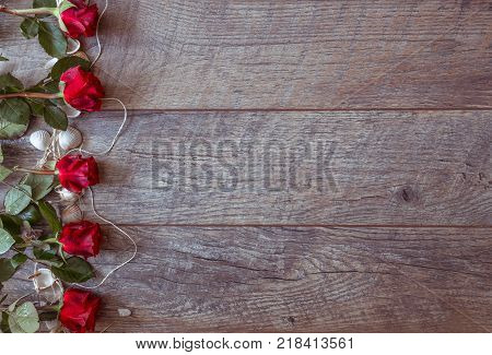 Valentines day background with red roses and shells. Wedding background. Top view, copy space. Mother's, Valentines, Women's Wedding Day concept.