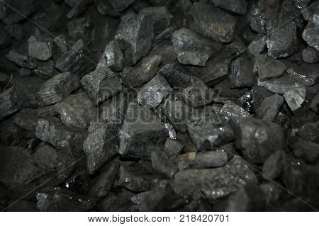Image of coal with shallow focus to highlight center of image and produce useful blurs at top and bottom for the addition of text etc.