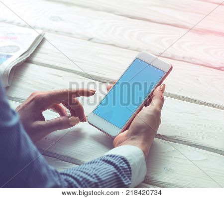 Woman working with a smartphone. Clipping path.