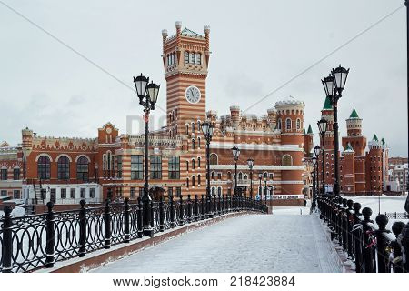 Yoshkar-Ola, Russia - December 6, 2016 View from the Sunday Bridge to the beautiful administrative building on Patriarch's Square in Yoshkar-Ola, Russia