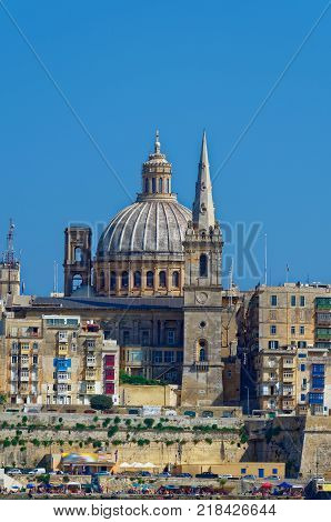 Basilica of Our Lady of Mount Carmel and St. Paul`s Pro-Cathedral in the foreground, Valletta, Malta