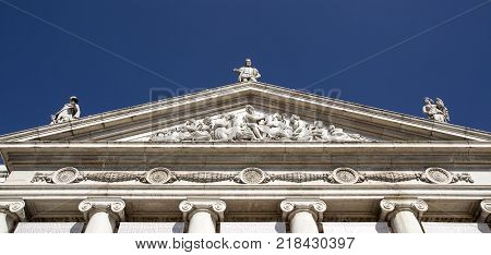 Pediment Ionic columns statues medallions are elements of the Neoclassical architecture on the facade of the Dona Maria National Theatre in Lisbon Portugal