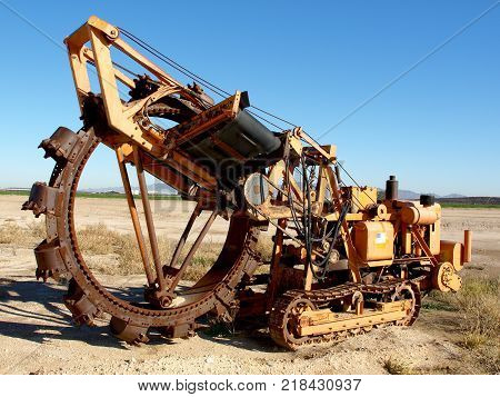 Taken in 2009. An old ditch digging machine I found on the edge of a farm field in Arizona. It had been sitting in this location for years and was rusting which means it had not been used for a long time and the ownership was unknown.