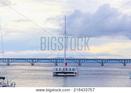 catamaran sailing in the sea on the background of the bridge