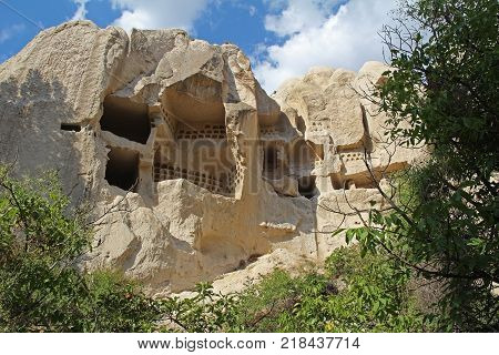 Natural valley with volcanic tuff stone rocks in Goreme in Cappadocia Central Anatolia region of Turkey. Popular tourist destination in Turkey for trekking.