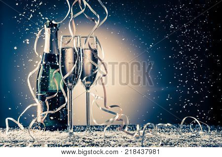 Bottle, two champagne wineglasses with silver and golden ribbons