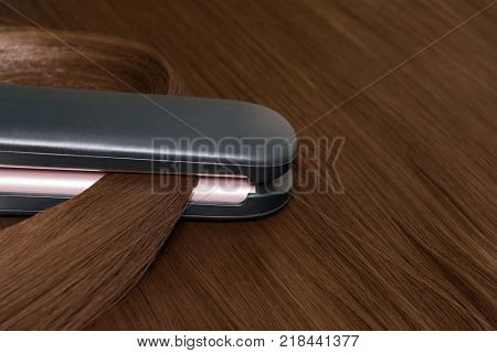 Hair straightener. Brilliant smooth beautiful hair and hair curler