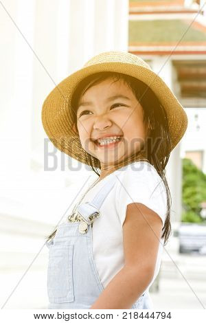 asian child girl smiling brightly or laughing with happiness