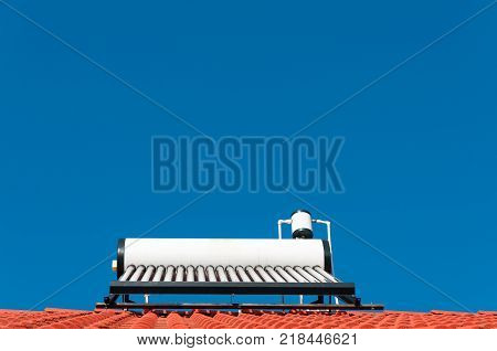 Solar water heater with perfect blue sky.