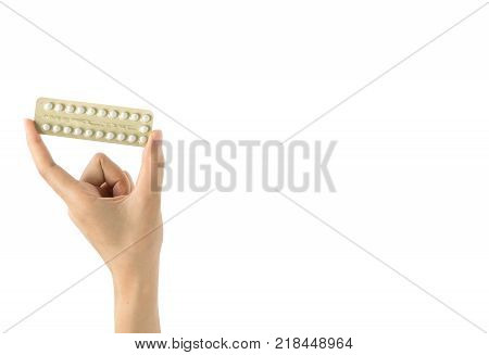 Woman hand taking birth control pills. Asian adult woman holding pack of contraceptive pills isolated on white background with clipping path. Choosing family planning with birth control pill concept
