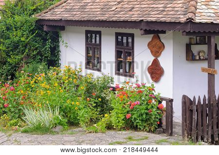Flowers in front of a traditional Paloc farmhouse in the UNESCO World Heritage village - Holloko, Hungary, 13 July 2013