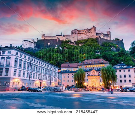 Colorful spring sunset in the Old town of Salzburg. Splendid view of Hohensalzburg Castle fortress. Austria Europe. Artistic style post processed photo.
