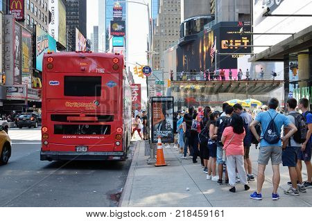 NEW YORK CITY - AUG. 24: Unidentified people on the Times Square in Manhattan on August 24 2017 in New York City NY. Times Square is a major tourist destination and entertainment center.