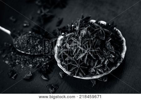 Close Up Of Star Aniseed,illicium Verum In A Plate With Its Powder.