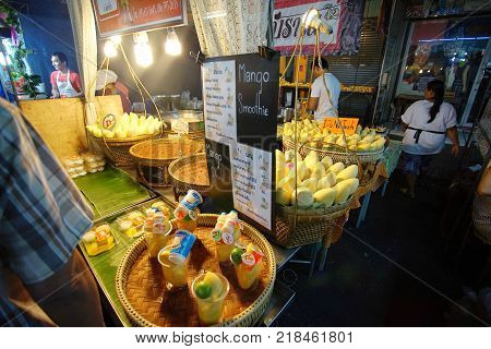 HUA HIN  THAILAND - 9 DEC 2017: Unidentified Tourists shopping and eating seafood at Hua Hin night market. Here is the biggest night market and very famous for foreign and Thai visitors.