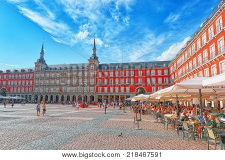 Madrid Spain- June 04 2017: Tourists on Plaza Mayor. Plaza Mayor - one of central squares of the Spanish capital. Located from another famous plaza- Puerta del Sol.