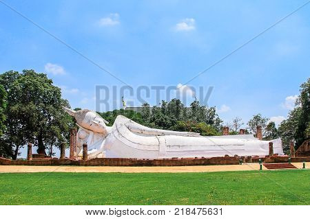 Reclining Buddha is a statue that represents Buddha lying down and is a major iconographic and statuary pattern of Buddhism at Wat Yai Chai Mongkol Ayutthaya historical park Thailand