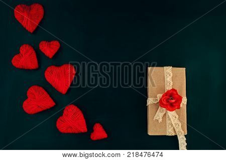 valentines day red hearts on a dark background with a gift space for text