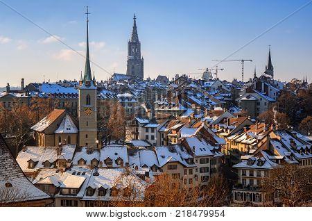 View of old part of city of Bern, Church of Nydeggkirche and Spire of Bernese Cathedral. Winter in Switzerland.