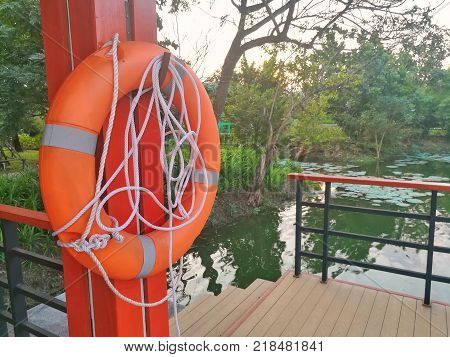 Lifebuoy, safety equipment, at the pier. Important safety equipment for lifesaving in river, lake and beach.