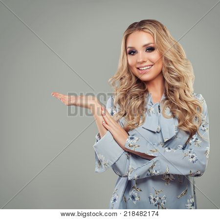 Perfect Woman with Empty Copy Space on the Open Hand on Gray Background
