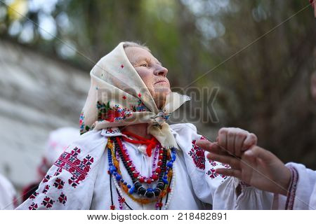 Belarus Gomel May 20 2017.Belarus Gomel May 20 2017. Holiday in the branch of the Vetkovsky Museum.An old woman dancing a dance in national clothes.Ethnic Slavic Dances.Grandmother dancing