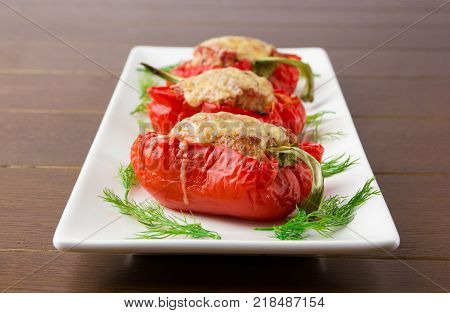 Pepper stuffed with meat. Baked Bulgarian pepper with minced meat and rice and cheese.