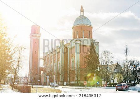 New evangelical church in backlight Kezmarok Slovak republic. Religious architecture. Travel destination. Yellow sun rays.