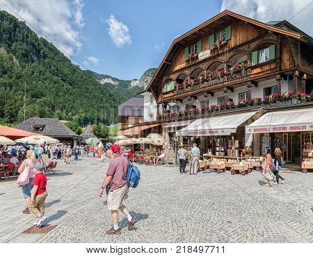 BERCHTESGADEN, GERMANY - JULY 08, 2017: People at square with restaurants of tourist resort Schonau am Konigssee near Berchtesgaden