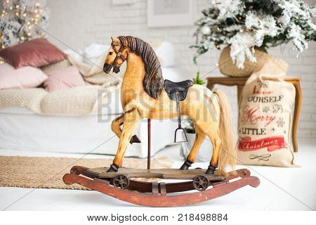 a wooden horse for Christmas. a gift for children. New Year's Little Horse