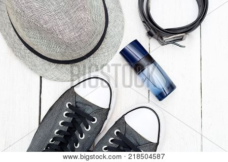 Men's everyday objects on a white wooden background. Flat lay