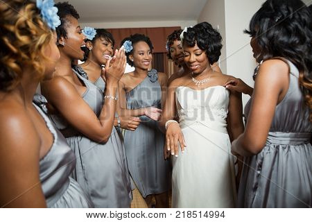 Bride with friends getting ready for her wedding.