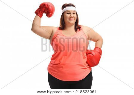 Overweight woman with boxing gloves flexing her biceps isolated on white background