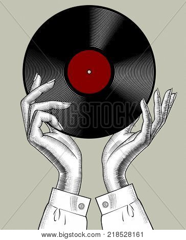 Woman's hands with a gramophone record. Retro music concept. Vintage stylized drawing