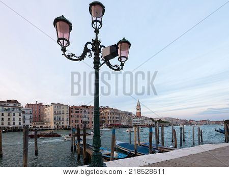 Panorama of Venice, Italy from Canale Grande with Piazza San Marco and the tower of St Mark's Campanile at sunset