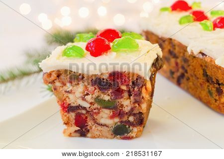 Traditional fruitcake with frosting.