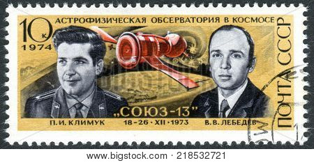 USSR - CIRCA 1974: A stamp printed in USSR dedicated to Cosmonautics Day shows the cosmonauts Pyotr Klimuk and Valentin Lebedev and spacecraft Soyuz 13 circa 1974
