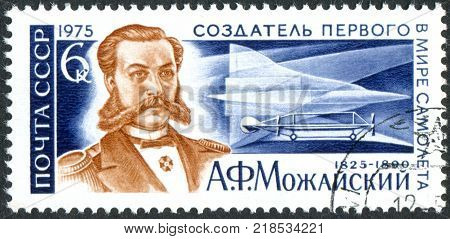 USSR - CIRCA 1975: A stamp printed in the USSR dedicated to the 150th Birth Anniversary of A. F. Mozhajski pioneer aircraft designer shows a portrait of Mozhajski Early Plane and Supersonic Jet TU-144 circa 1975