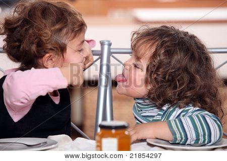Children pulling faces