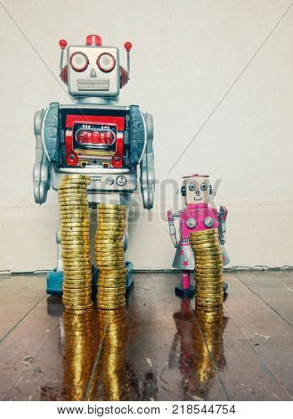 concept inequality wit two vintage robot toys on a wooden floor with reflection