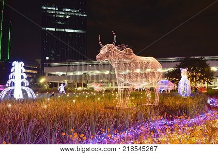 Bangkok Thailand December 16, 2017 :  cow LED light show ones of Chinese zodiac in Thailand illumination festival 2017 on night