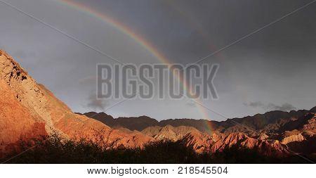 Rainbow over the barren lands in Arizona
