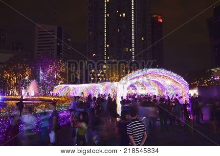 Bangkok Thailand December 16, 2017 :  ambiance of traveler visit and watch LED light tunnel in Thailand illumination festival 2017 on night