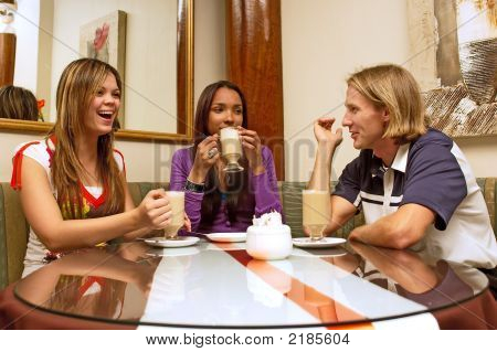 Three Friends Are Drinking Coffee