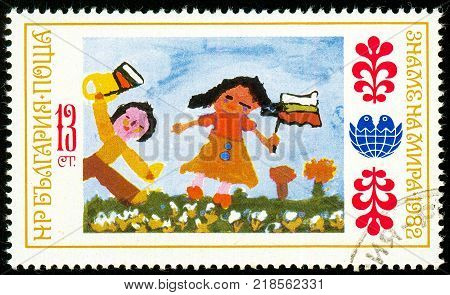 UKRAINE - circa 2017: A postage stamp printed in Bulgaria shows children's drawing holiday Series International Children's Assembly Banner of Peace circa 1982