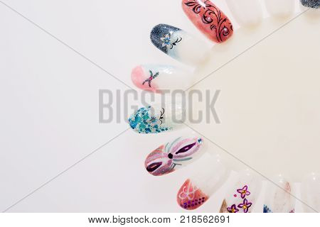 Collection of artificial finger nail with beautiful nail design. Finger nail art design samples