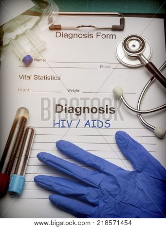 Diagnostic form, HIV / AIDS, Vial of blood samples and Medicine in a hospital, conceptual image